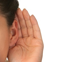 White background hand behind ear to represent listening